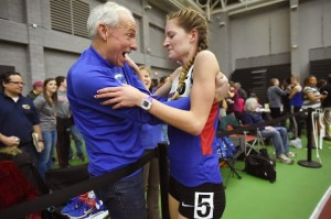 Coginchaug's Alex Alsup and coach Jack McShane celebrate her victory at the Class S championship. Catherine Avalone - New Haven Register.